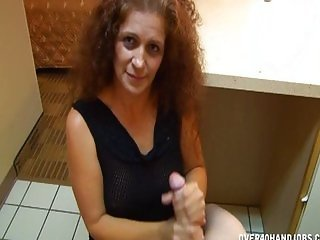 Mature lady in a hotel room