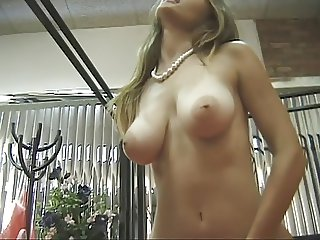 Slim naked chck plays with her twat