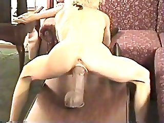 She stretches cunt with a huge toy