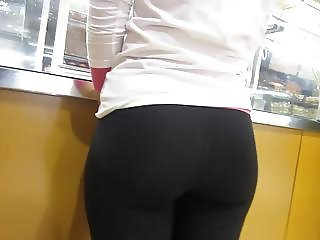 Stunning brunette with shapely buttocks in tight spandex