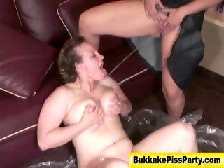 Nasty watersports babe gets soaked