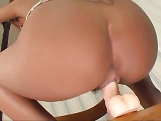 Tanned asian girl rides a white dildo