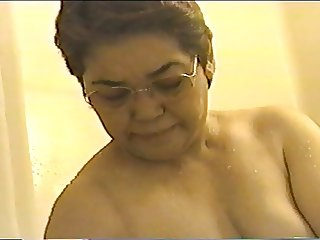 Japanese granny washes and wipes her plump pussy thoroughly