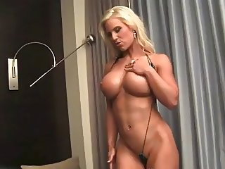 Well-built tanned blonde Megan posing naked