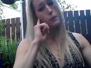 Blonde Cutie smoking a strong cigarette
