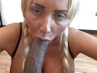 Hot blonde sucking on black dick POV