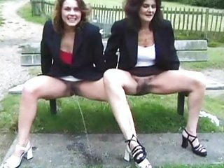 British mother daughter pissing outdoor