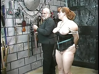 Cute thick slave girl in corset is restrained and humiliated by her master