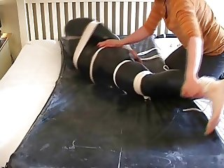 tied guy in pvc made to cum in his catsuit