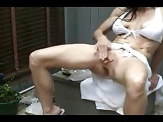 JUST A MATURE SQUIRTER SHOWING HER SKILLS IN THE GARDEN