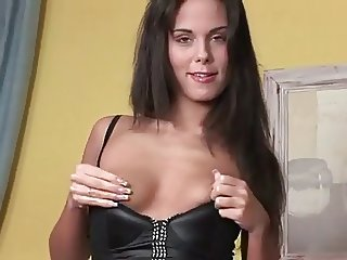 Long Haired Brunette Takes Off Her Black Leather Dress