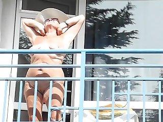 Posing on the balcony