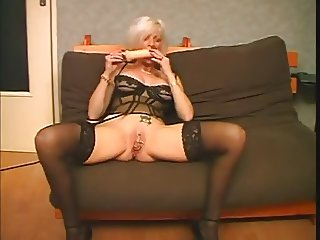 Mature with toy and pierced