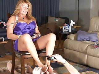 Step-mom gives cuck slick footjob