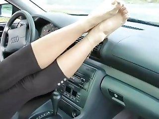 Beautiful feet in a car