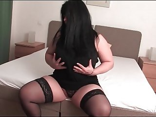 chubby mature lady rubs pussy