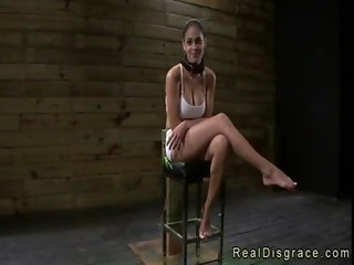 Busty brunette Jasmine Caro chained to a post and deep throat fucked
