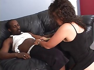 Black guy fucks sexy brunette on sofa