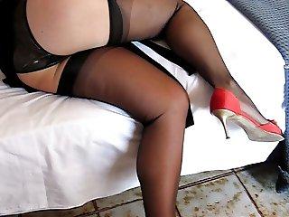 Filming her legs in black stockings