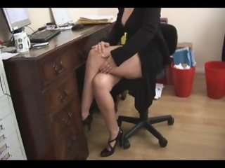 Busty mature blonde secretary strips and spreads