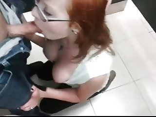 redhead sucking dick in public toilet
