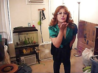 Wife Stripteases in a Green satin blouse and Black Skirt