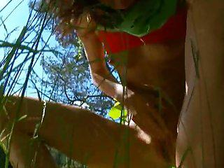 Petite french chick peeing in a forest