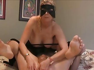 Prostate massage by wife on the bed