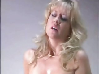 Sweaty mature riding a sybian