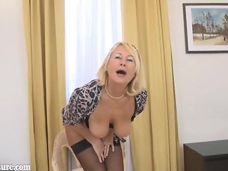 Blonde granny undressing in front of camera