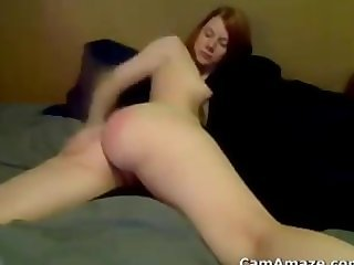 Redhead Spanks Her Pale Ass