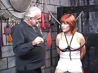 Aging red-head tethered, bound and whipped in torture chamber