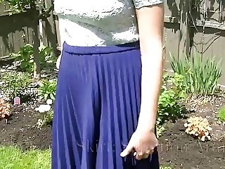 Cute girl wearing pleated skirts.
