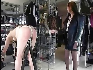 Leather Mistress uses crop