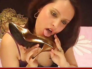 Sexy girl play with her high heels