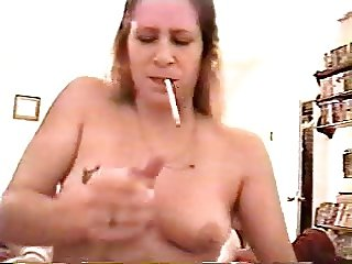 Tina gives an intense smoking handjob