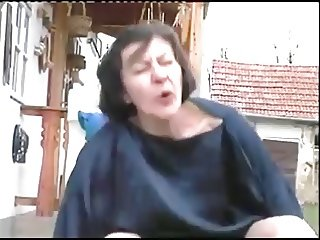 Grannie fucks Young man in outdoors