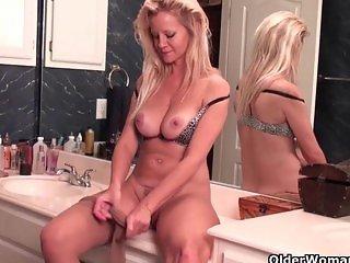 Busty soccer mom masturbates in nylons