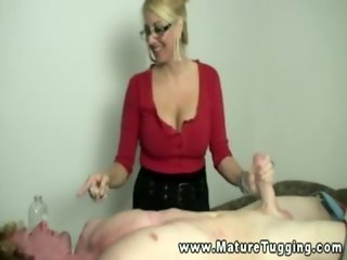 Mature milf in glasses tuggs cock