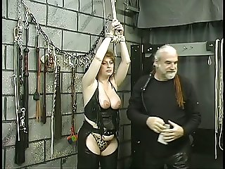 Kinky blonde has some S & M fun with her master