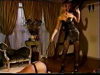 Dominatrix whips her sub