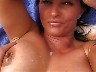 Busty MILF oils up her hot tits