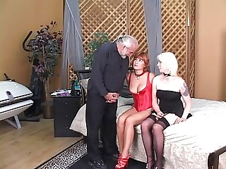 Blonde makes red head suck her pussy while man watches