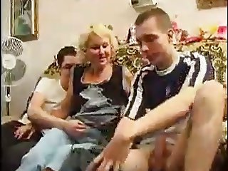Blonde Mature Takes Two Cocks At The Same Time