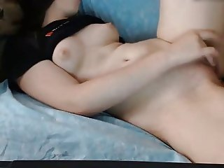 Teen strokes her pussy and rubs tits