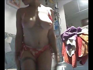 busty milf in bikini bathroom