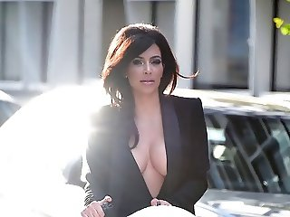 Kim K braless cleavage