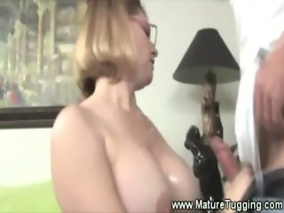 Milf in spex tugging cock for guy and gets her tits out