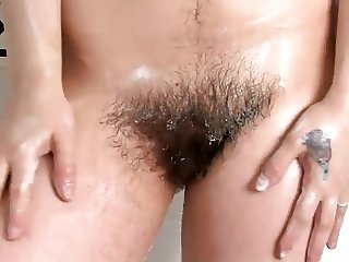 beautiful english brunnette bathes her awesome hairy pussy