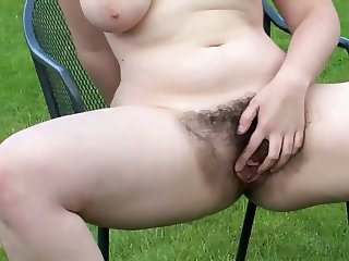 beauty walks around the garden shows her meaty hairy pussy